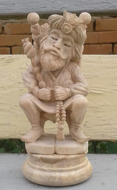 Chess king figure wood carving